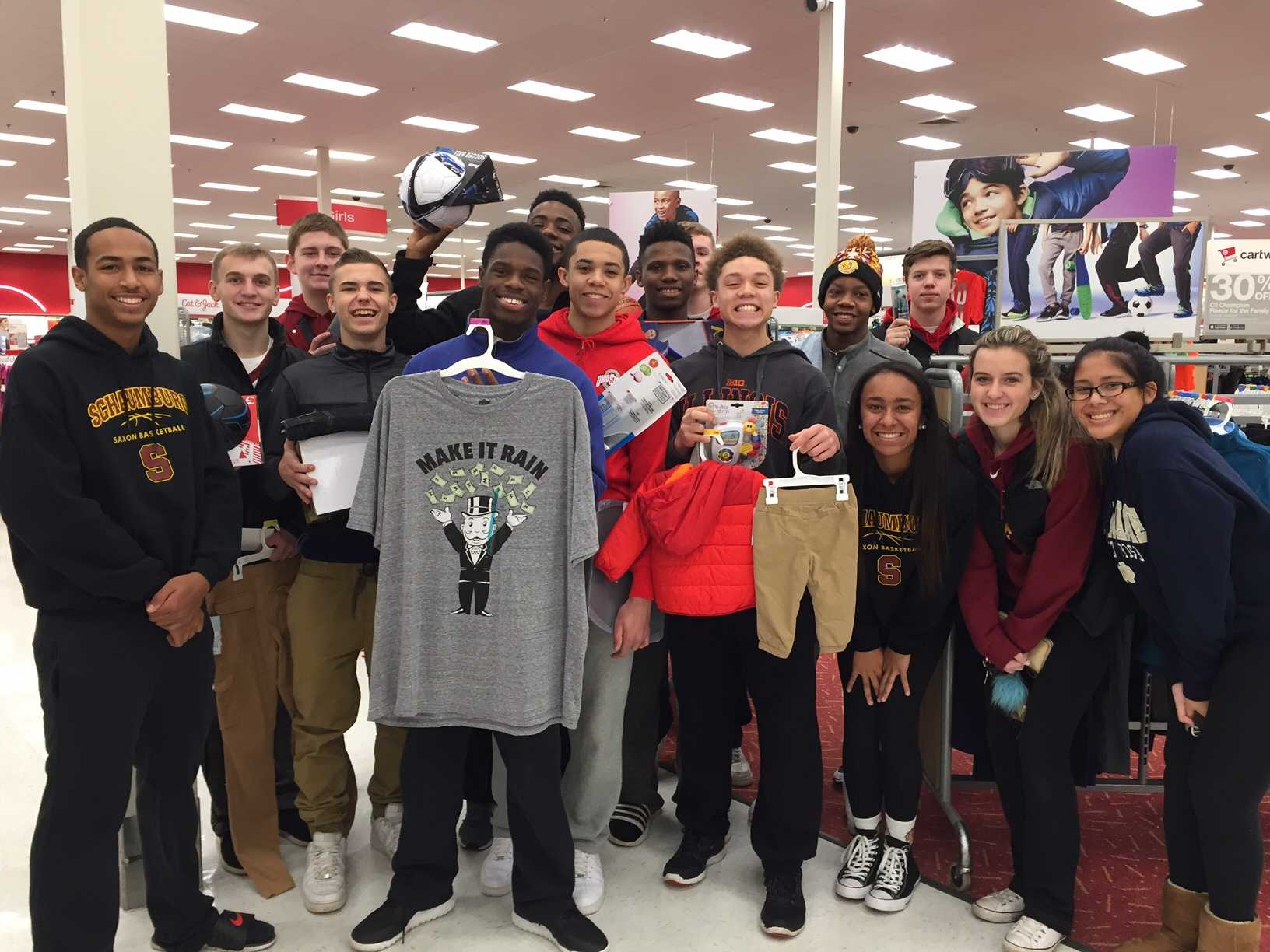 The boys' basketball team shops for their adopted family as part of the SHS Adopt-a-Family. Schaumburg High School students and staff provided gifts for members of 19 families and four senior citizens.
