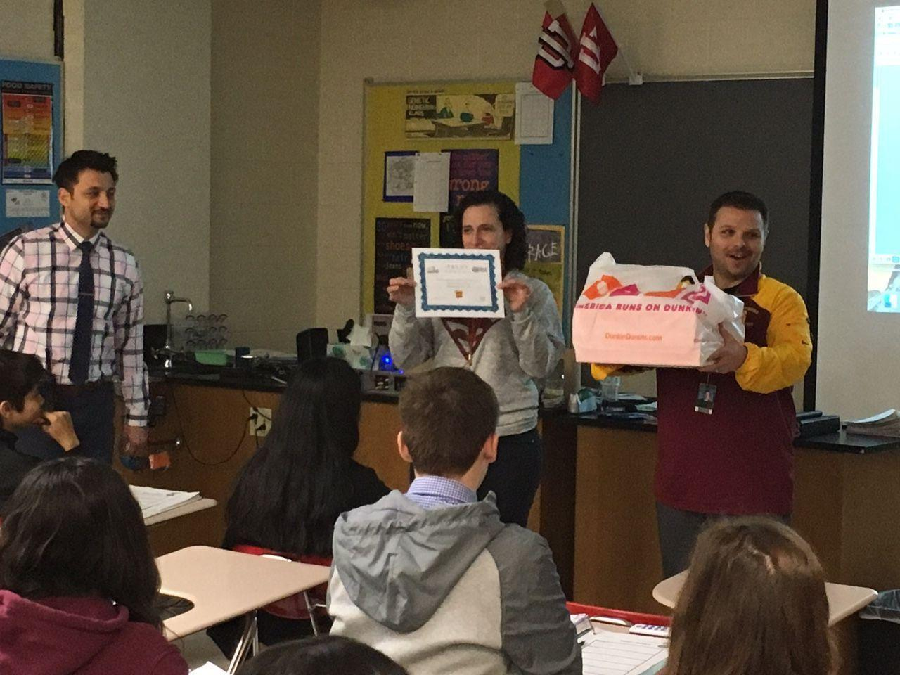 Mr. Matarazzo and Mr. Mehreioskouei award Mrs. Hensley's class for winning the Trudy competition.  Classes will continue to compete throughout the remainder of the school year.