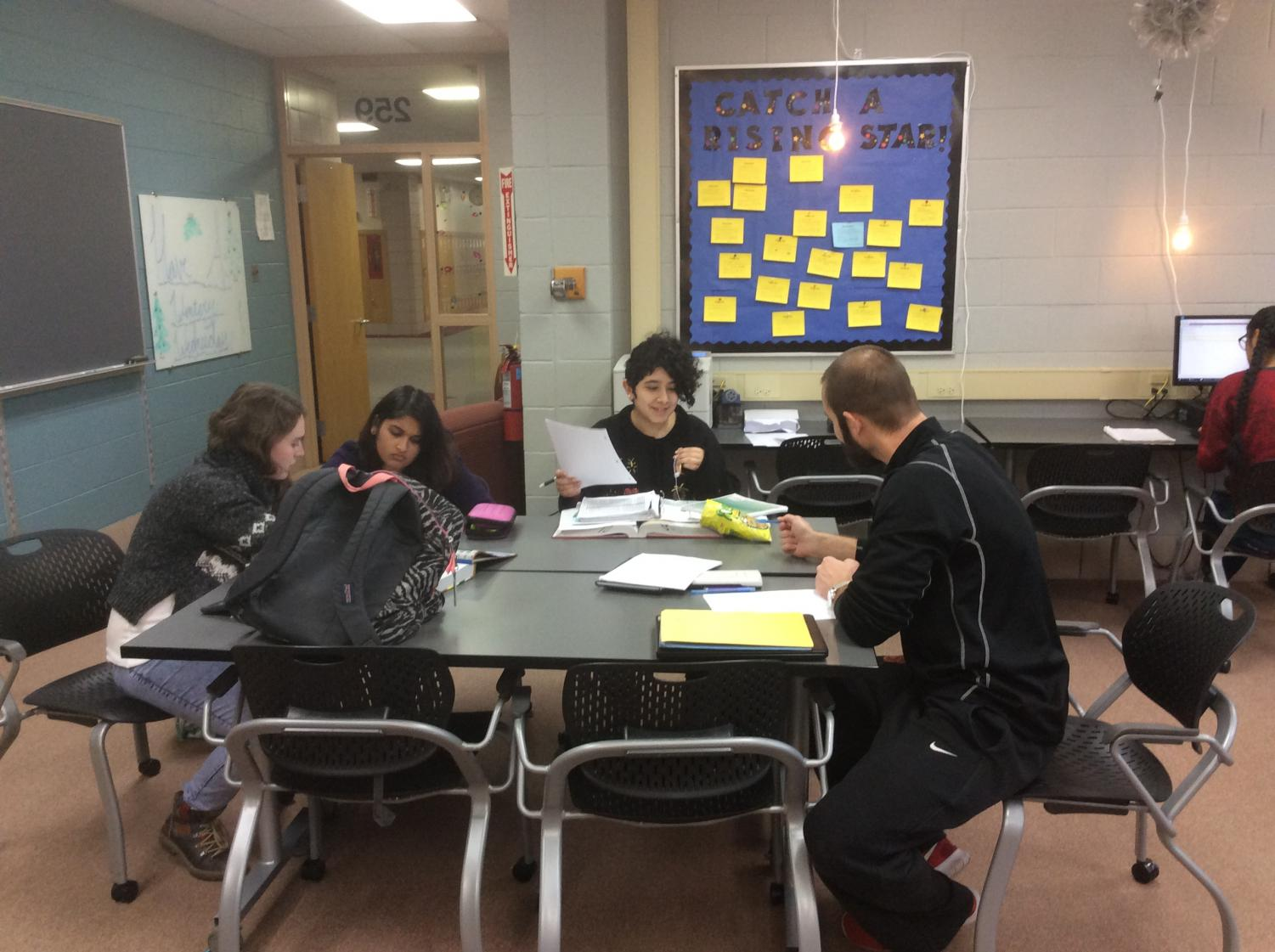 Mr. Rafaj works with students after school in the AP resource room