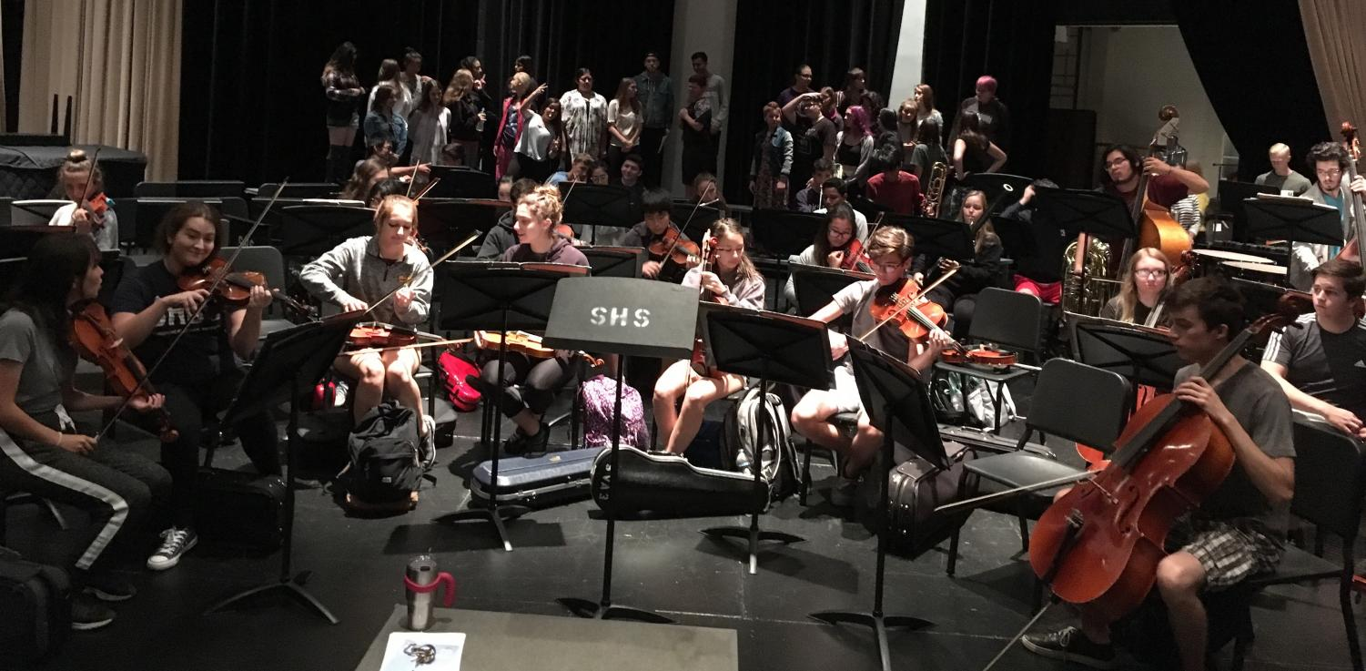 The SHS orchestra and choir rehearse for the annual Mosaic Concert.