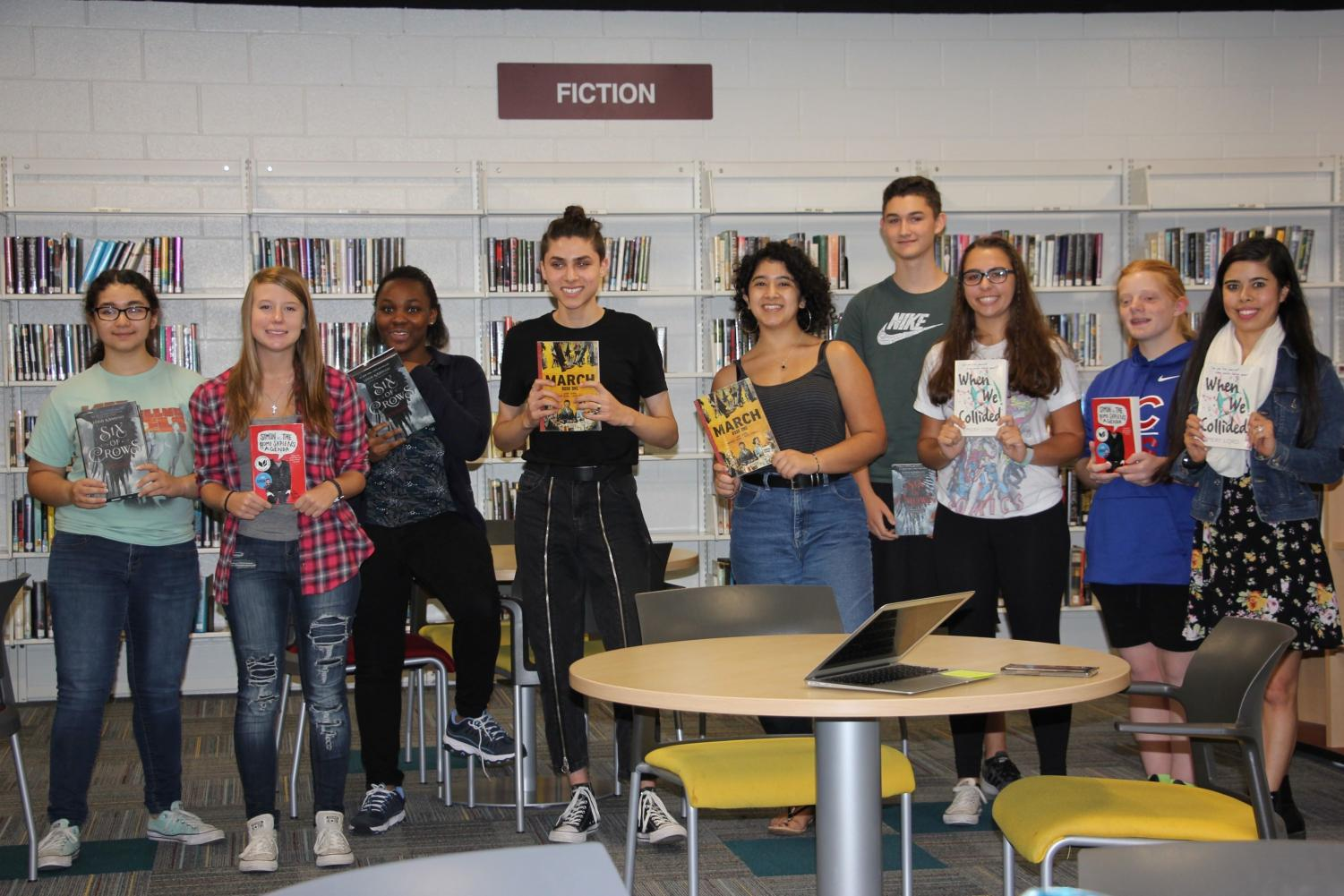 Members of Book Club hold their novels of choice. Book Club meets every Thursday in the Media Center.