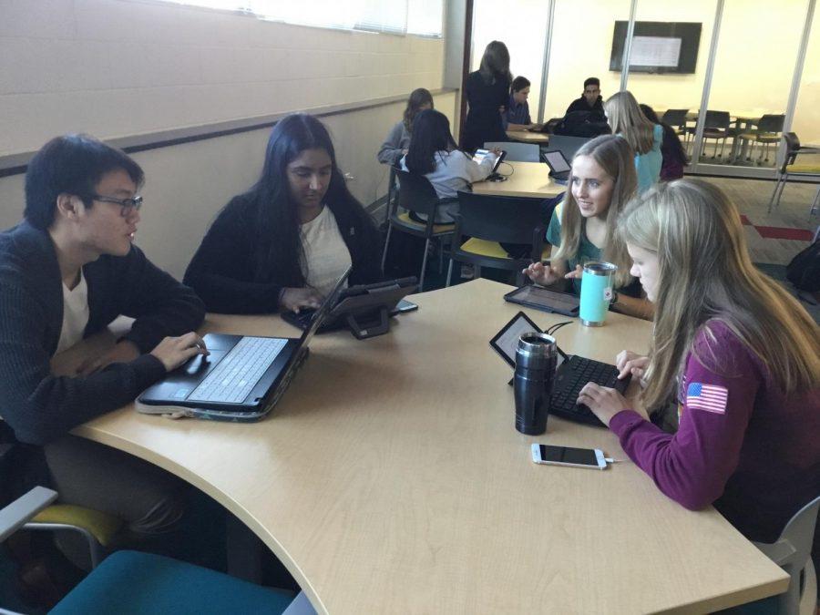 Megan Gale, Hollie Korreckt, Lakshmi Sivaraman, and Raphael Portillo discuss their college applications during Mrs. Gilkey's AP English class.