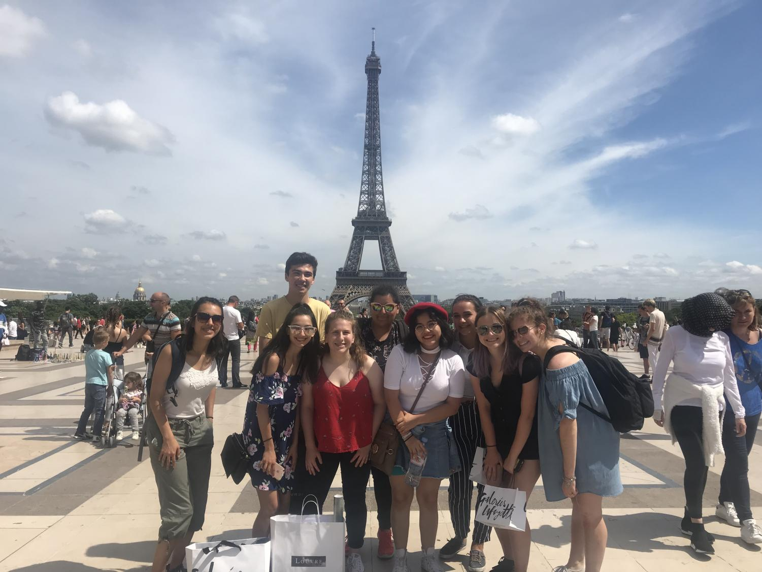 Students pose for a photo at the Eiffel Tower in Paris, France as apart of the foreign exchange program. The foreign exchange program allows students to travel to a country of the language they learned throughout the years.
