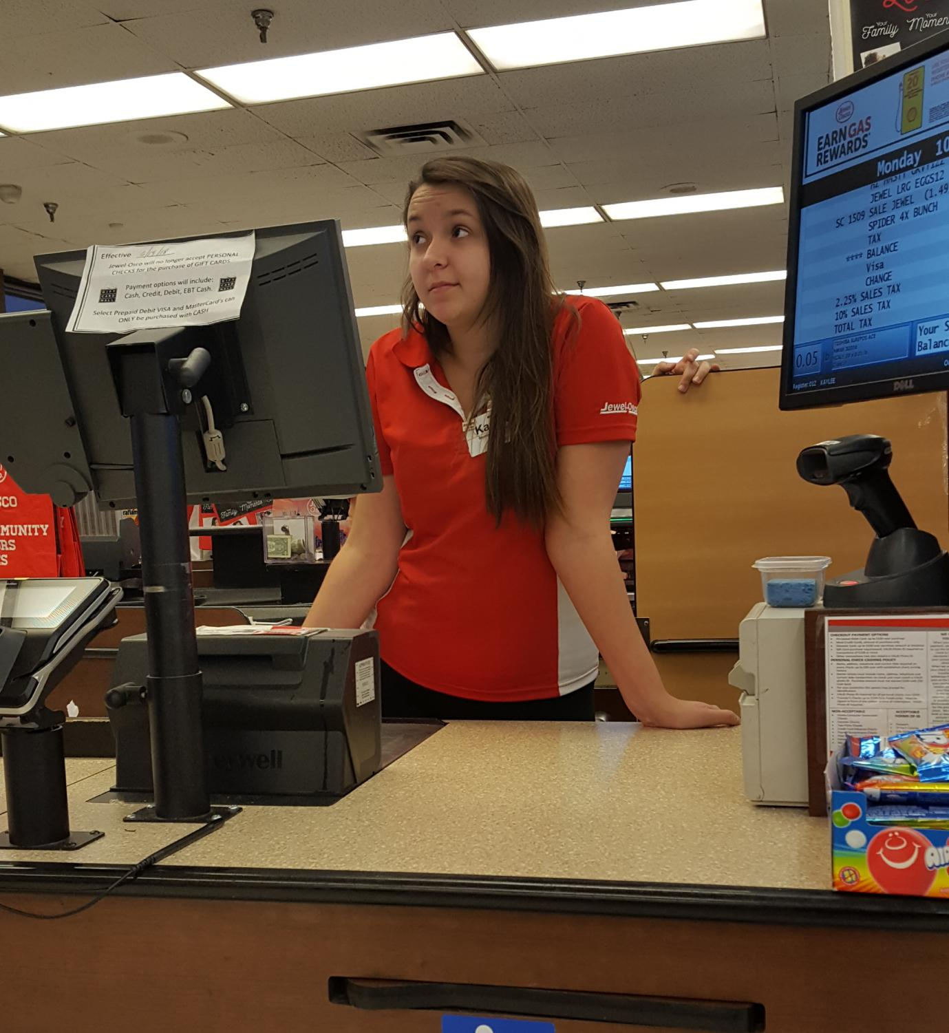 Kaylee Kalvig awaits her next customer in the check out line at Jewel.