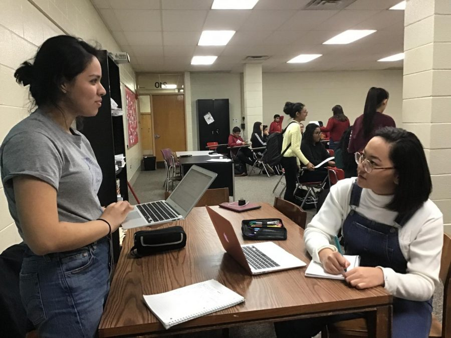 Stephanie Portillo works with Baigalmaa Gansukh at debate practice.