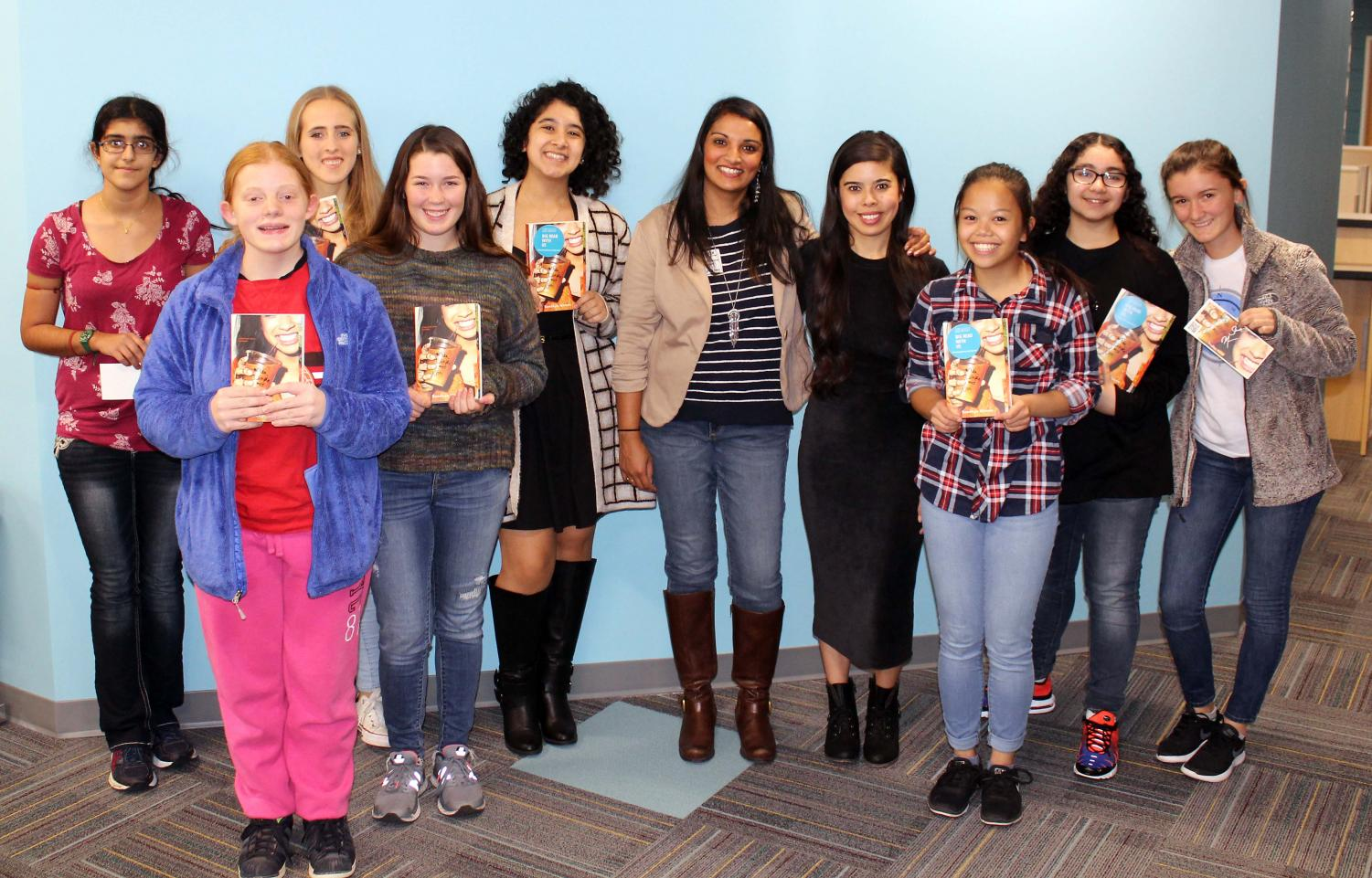Members of the Reading Club pose for a photo with Sandhya Menon during her visit to SHS.