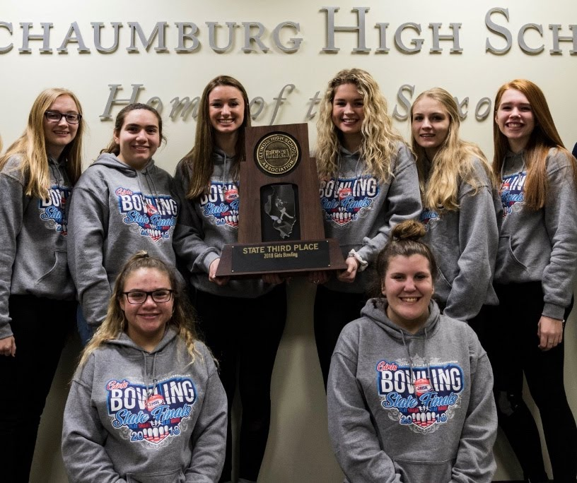 Schaumburg High School's girls' varsity bowling team poses with the third place state trophy.  The Saxons are looking to capture the 2018-2019 state title.