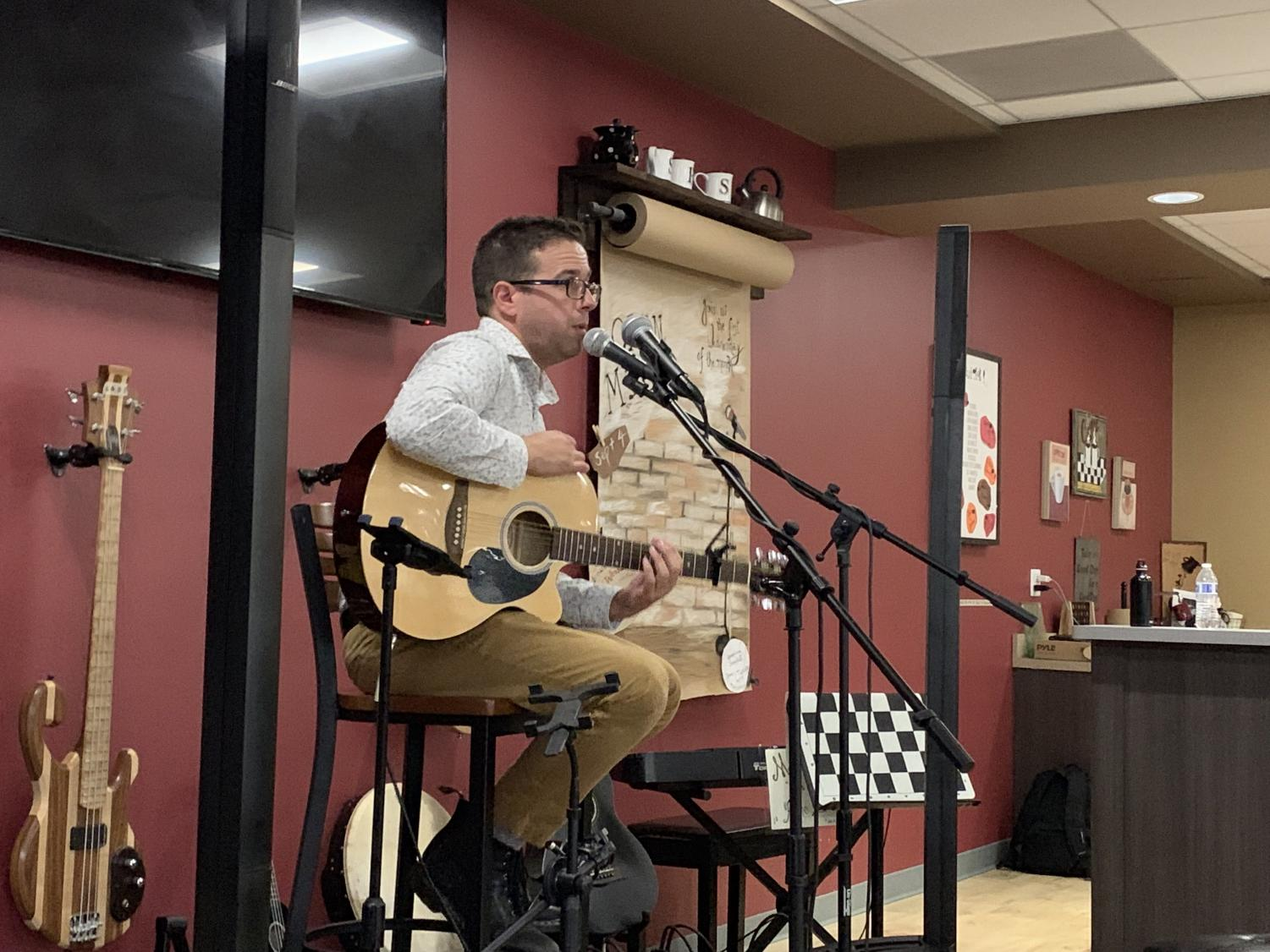 Mr. Elwell performs a song at the first Open Mic Night on September 4 in Siegie's Corner.