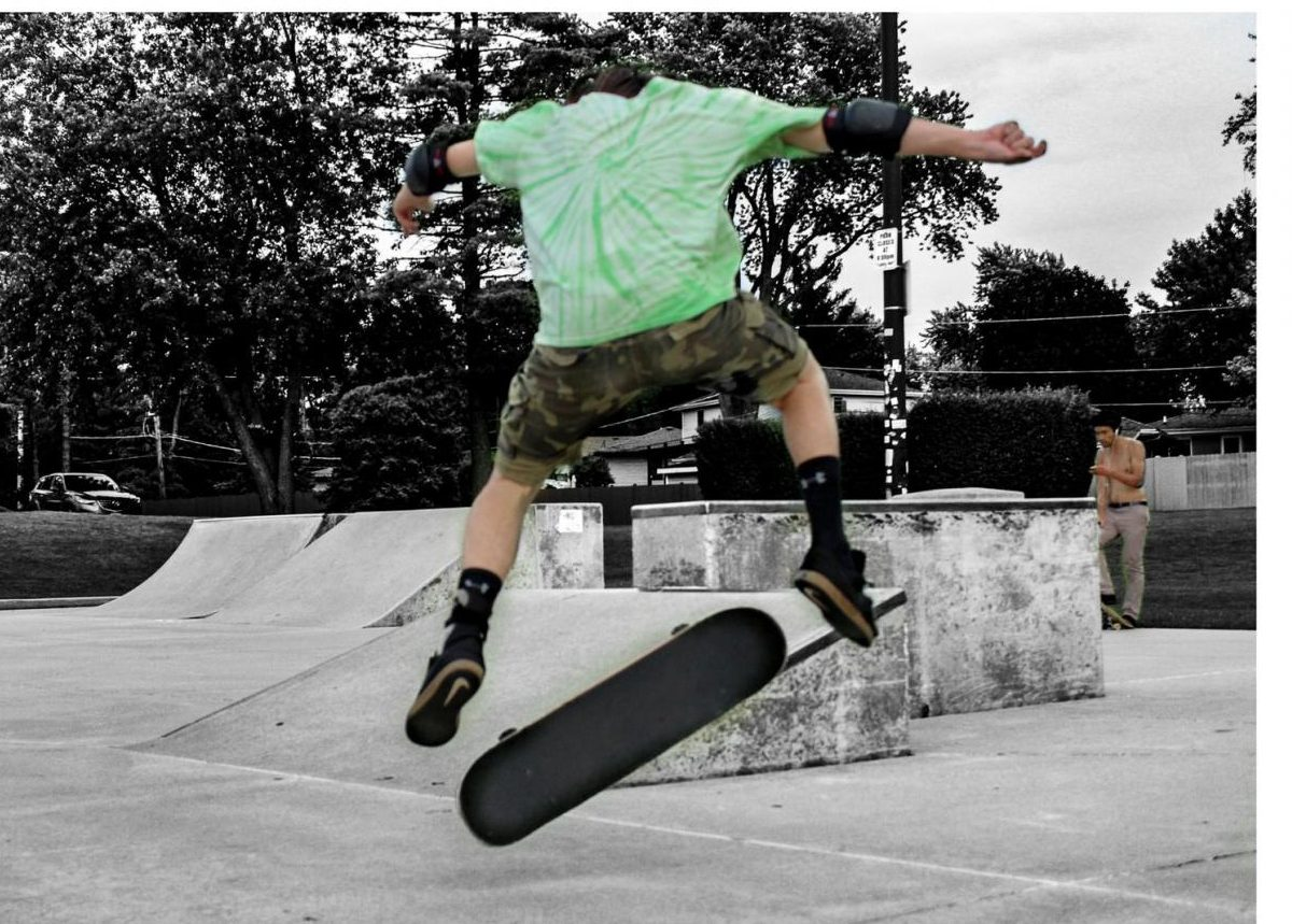 John Markos performs a kick flip at the Roselle Skate Park.