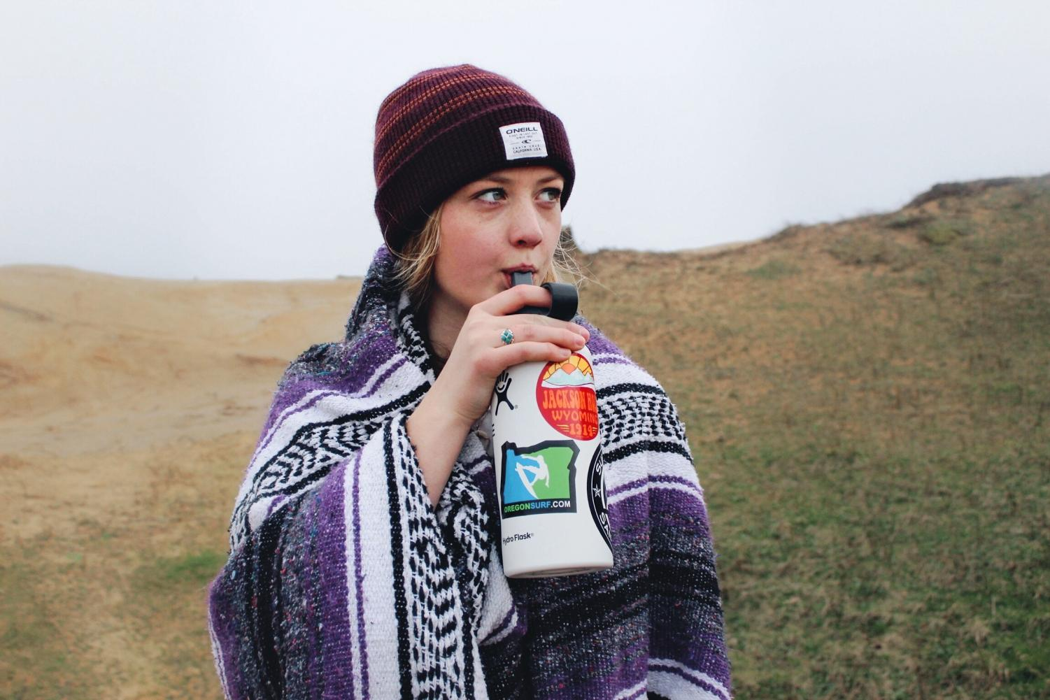 A VSCO girl hydrates while enjoying nature.