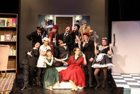 "The cast of ""Clue"" pose for a pre-show photo. ""Clue"" ran November 21-23."