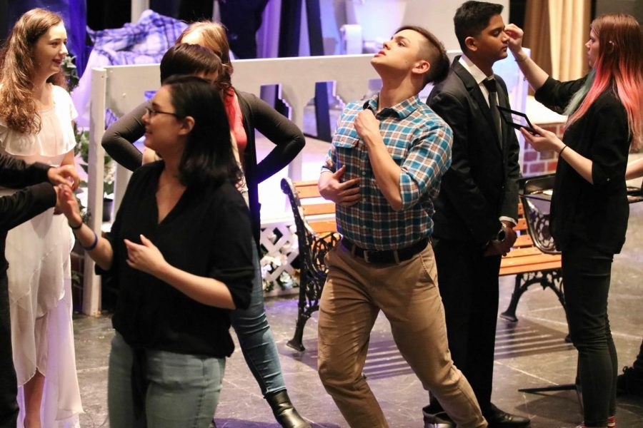 "The cast of ""Love/Sick"" rehearses prior to their performance."