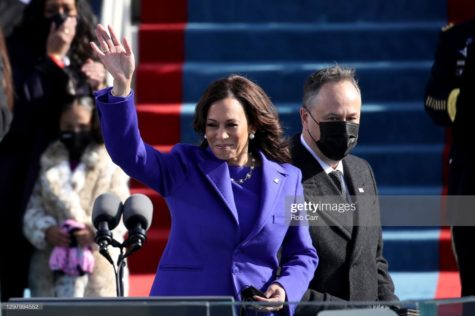 Newly sworn in U.S. Vice President Kamala Harris and her husband Doug Emhoff wave at the gathered crowd.